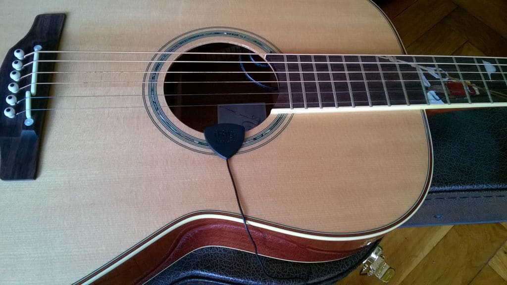 Mounting the iRig Acoustic Stage to an acoustic guitar is an easy task.